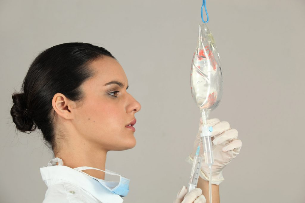 nurse injecting on the dextrose bag