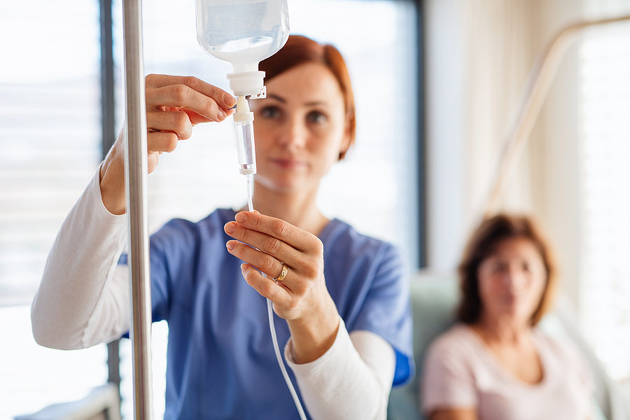 a nurse managing a dextrose bag