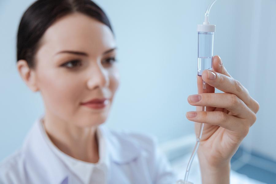 a nurse managing the iv drip
